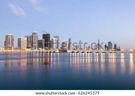 Miami waterfront buildings illuminated at twilight. Florida, United States