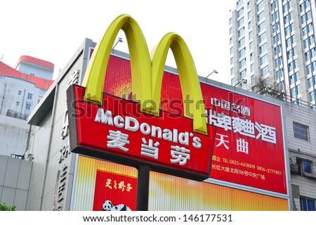 MIANYANG, CHINA - May 31: A Logo of McDonalds at a restaurant in MianYang, China on May 31, 2013.McDonald's is one of the main fast-food restaurant chain in China. - stock photo