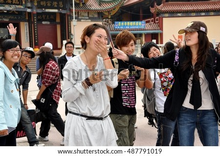 Mianyang, China - October 15, 2010:  A group of Chinese university students on a visit to the Sheng Shui Buddhist temple