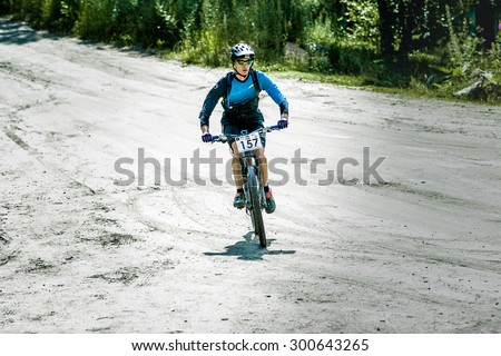 "Miass, Russia - July 19, 2015: mountainbiker during the race ""Clean water-2015"", Miass, Russia - July 19, 2015"