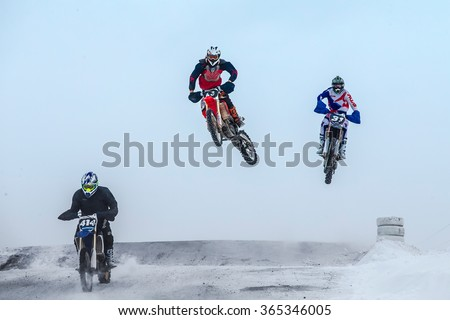 Miasskoe, Russia -  January 16, 2016: high jumps and flight riders on motorcycle at winter motocross during Cup of Urals winter motocross