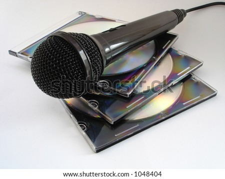 mic and CDs - stock photo