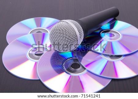 Mic on cd discs, closeup on table - stock photo
