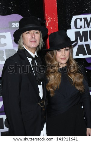 Michael Lockwood and Lisa Marie Presley at the 2013 CMT Music Awards, Bridgestone Arena, Nashville, TN 06-05-13