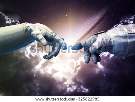 Michelangelo God's touch. Close up of human hands touching with fingers in space. Elements of this image furnished by NASA - stock photo