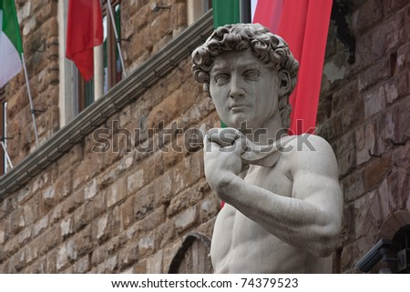 Michelangelo's David statue in Florence, Italy - italian flags on background - stock photo