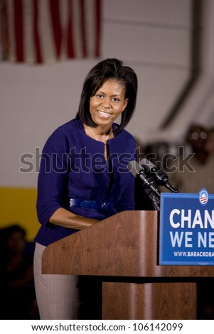 Michelle Obama speaking in front of African American audience during Barack Obama Presidential Rally, October 29, 2008 in Rocky Mount High School, North Carolina - stock photo