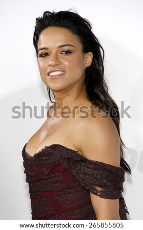 Michelle Rodriguez at the Los Angeles premiere of 'Furious 7' held at the TCL Chinese Theatre IMAX in Hollywood, USA on April 1, 2015.  - stock photo