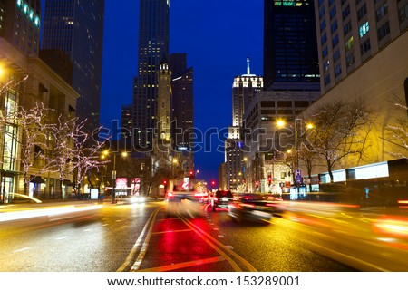 Michigan Avenue and Magnificent Mile with traffic at night, Chicago, IL, USA