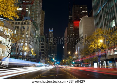 Michigan Avenue in Chicago. Image of busy traffic at Chicago night street. - stock photo