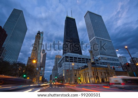 Michigan Avenue in Chicago. Image of busy traffic at the street of Chicago during  sunset blue hour. - stock photo