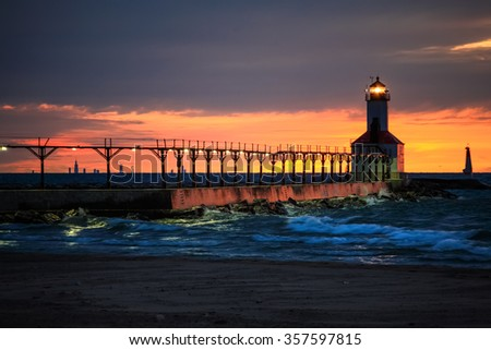 Michigan City, Indiana lighthouse with Chicago skyline on the ho - stock photo
