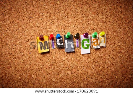 Michigan  - Cut out letters pinned on a notice board. - stock photo