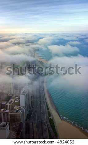 Michigan lake shore covered by clouds aerial view at sunset - stock photo