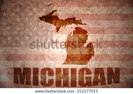 michigan map on a vintage american flag background - stock photo