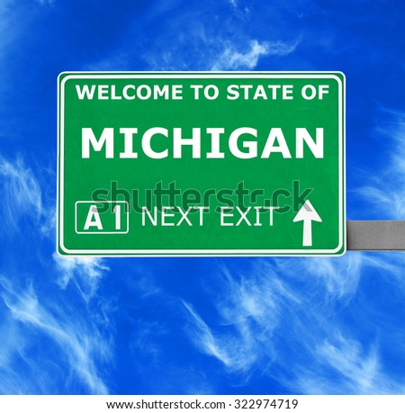 MICHIGAN road sign against clear blue sky - stock photo