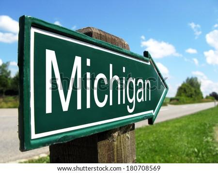 Michigan signpost along a rural road - stock photo