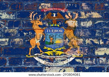 Michigan state flag of America on brick wall - stock photo