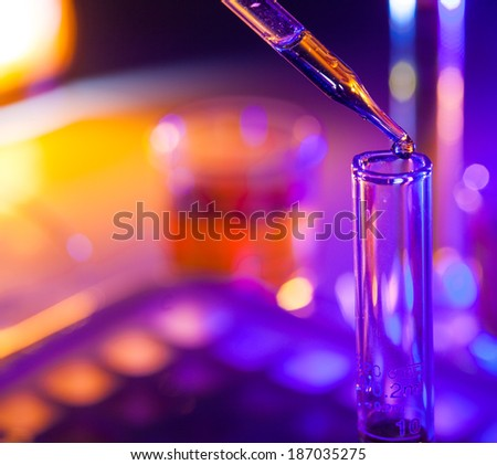 Microbiological pipette in the genetic laboratory - stock photo
