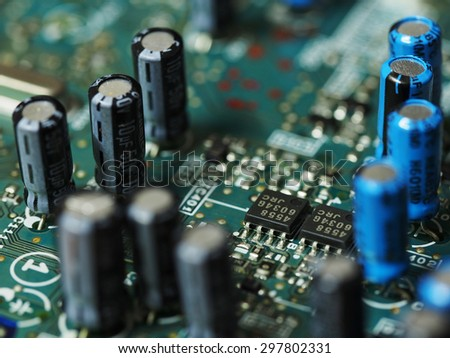 Microchip integrated on electronic circuit board selective focus - stock photo