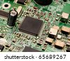 Microchip on a circuit board - stock photo