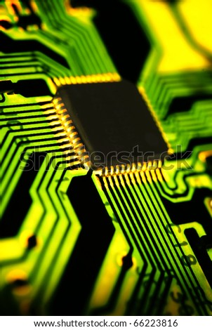 Microchip on circuit board, backlit. - stock photo