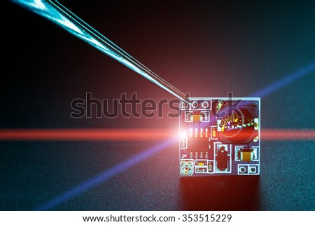 Microchip on PCB printed circuit board - stock photo