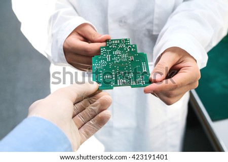 Microchip production factory. Computer expert. - stock photo