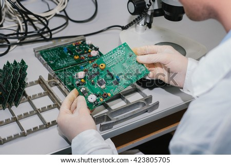 Microchip production factory. Computer expert - stock photo