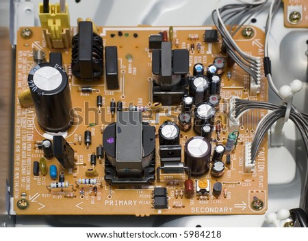 Microchips and Electronic Components on Printed Circuit Board Device - stock photo