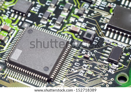 Microchips  by other elements on a circuit board - stock photo