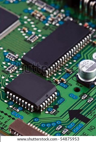 Microchips on circuit board - stock photo
