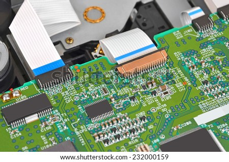 Microcircuit inside of dvd disk drive, close up, DOF - stock photo