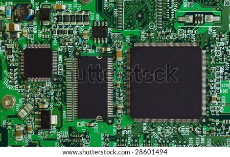 Microcircuit technology: chips on green board - stock photo