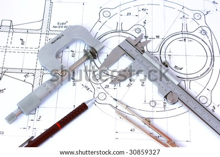 Micrometer, Caliper, Mechanical Pencil and Compass on Technical Drawing. - stock photo