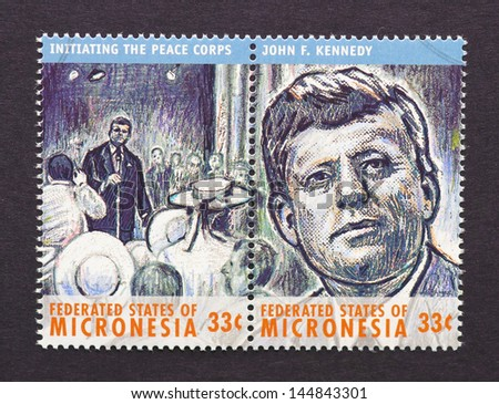 MICRONESIA - CIRCA 2000: two postage stamps printed in Micronesia  showing an image of John Fitzgerald Kennedy speaking to the Peace Corps, circa 2000.