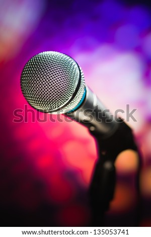 microphone against purple background - stock photo