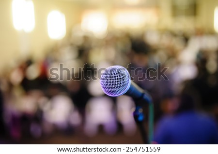 microphone against the background of convention center - stock photo
