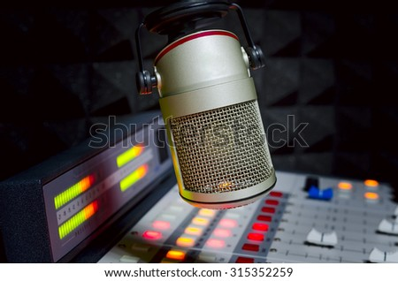 microphone and audio console in radio show studio