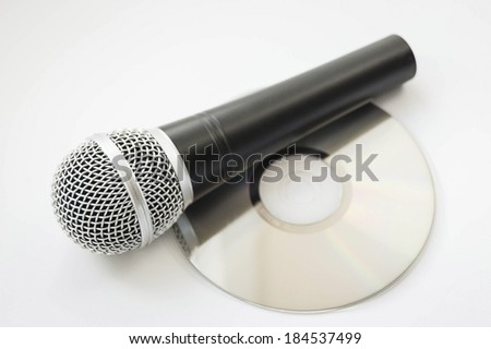 microphone and cd disc on a white background - stock photo