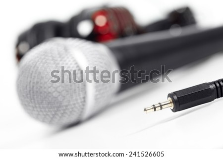 Microphone and headphones on the table. Music and singing