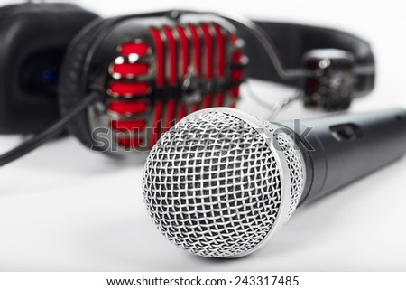 Microphone and headphones on the table. Music and singing - stock photo