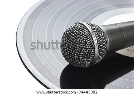 microphone and old vinyl record - stock photo