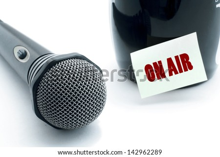 microphone and on air notice stuck on drinking mug - stock photo