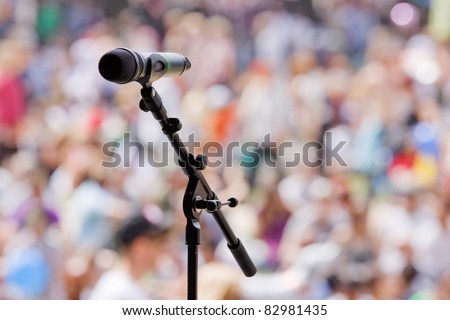 Microphone awaiting the next performer at an outdoor concert - stock photo