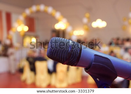 Microphone close up in a celebratory room