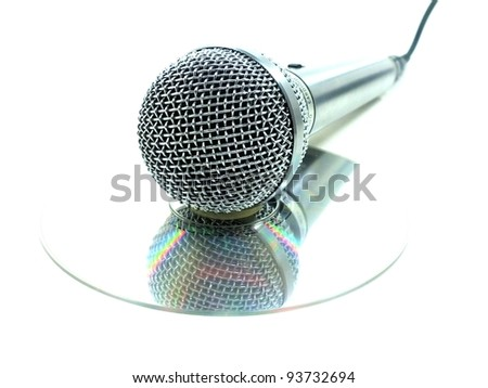 Microphone For Karaoke Reflected on CD Single Item - stock photo