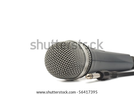 Microphone for karaoke with jack, isolated on white background - stock photo