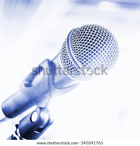 Microphone for sound, music, karaoke in audio studio or stage. Mic technology. Voice, concert entertainment background. Speech broadcast equipment. Live pop, rock musical performance.