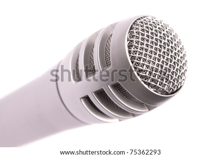 Microphone head, isolated. Selective focus on the front mesh - stock photo